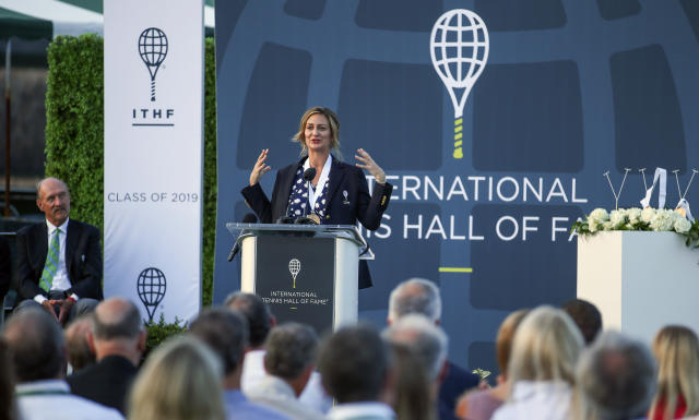 Tennis Hall of Fame inductee Mary Pierce, of France, speaks to the crowd, during ceremonies at the International Tennis Hall of Fame, Saturday, July 20, 2019, in Newport, R.I. (AP Photo/Stew Milne)