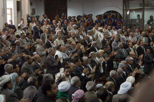 Yemeni MPs attend the swearing-in ceremony for President-elect Abdrabuh Mansur Hadi