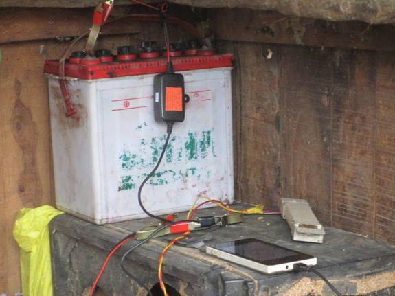 Smartphones connect to a solar-charged battery in the Barabanki district in Uttar Pradesh, India.