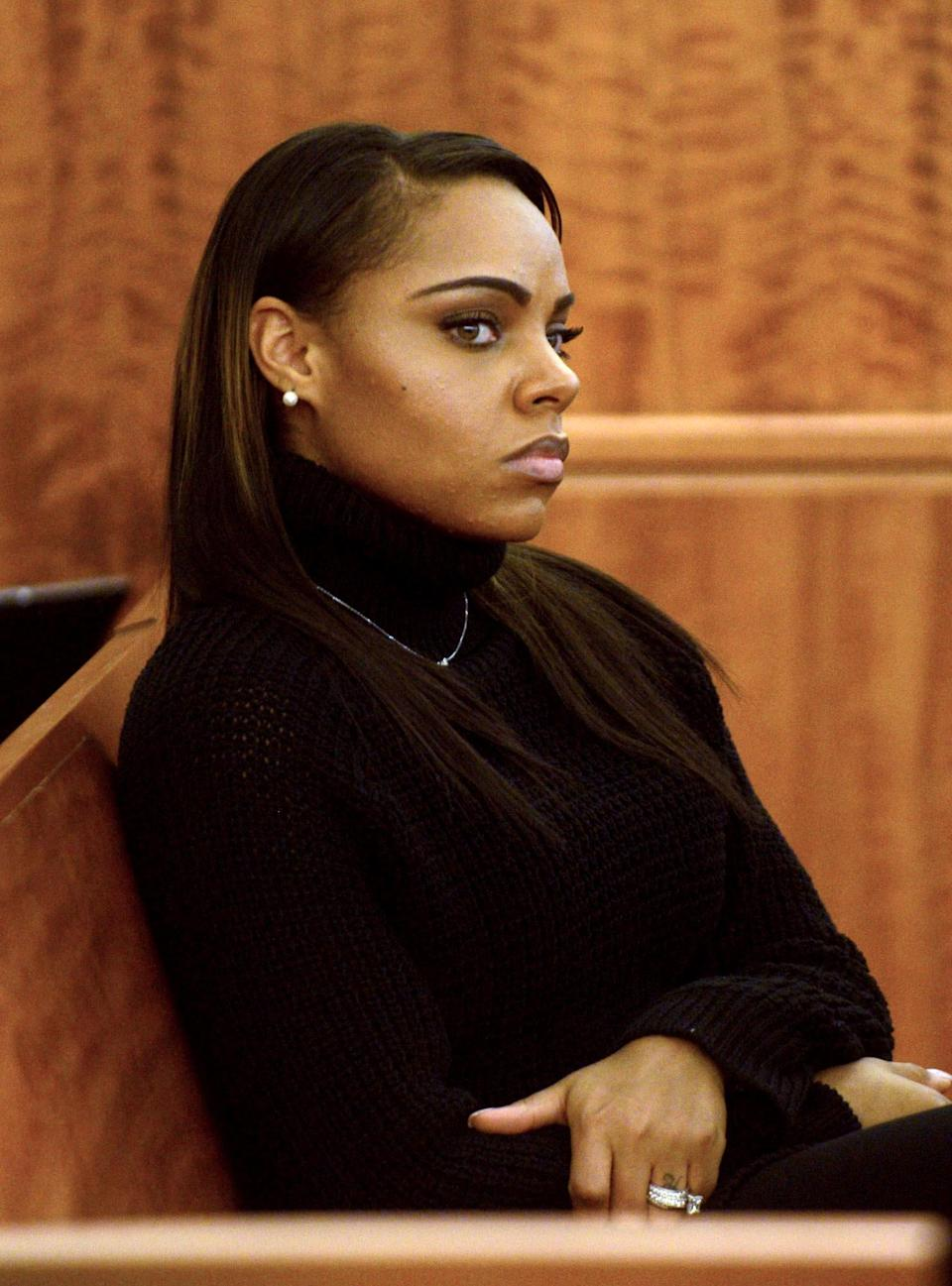 Former New England Patriots football player Aaron Hernandez's fiancee Shayanna Jenkins sits during his murder trial at Bristol County Superior Court in Fall River, Massachusetts February 11, 2015. REUTERS/Ted Fitzgerald/Pool (UNITED STATES - Tags: CRIME LAW SPORT FOOTBALL)