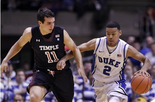 Duke guard Quinn Cook (2) dribbles as Temple guard T.J.DiLeo (11) tries to make a steal during the first half of an NCAA college basketball game in in East Rutherford, N.J., Saturday, Dec. 8, 2012. (AP Photo/Mel Evans)