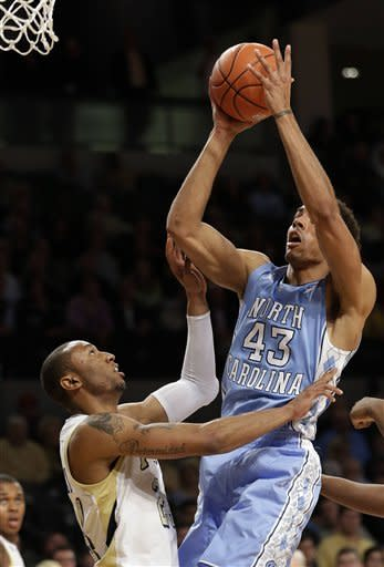 North Carolina forward James Michael McAdoo (43) shoots as Georgia Tech forward Kammeon Holsey defends during the first half of an NCAA college basketball game Tuesday, Feb. 19, 2013, in Atlanta. (AP Photo/John Bazemore)