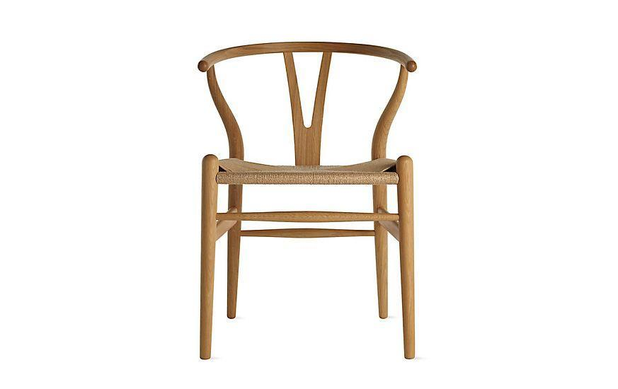 """<p><strong>Hans Wegner</strong></p><p>dwr.com</p><p><strong>$701.25</strong></p><p><a href=""""https://go.redirectingat.com?id=74968X1596630&url=https%3A%2F%2Fwww.dwr.com%2Fdining-chairs-and-stools%2Fwishbone-chair%2F2582.html%3Flang%3Den_US&sref=https%3A%2F%2Fwww.redbookmag.com%2Fbeauty%2Fg37132432%2Fchair-types-styles-designs%2F"""" rel=""""nofollow noopener"""" target=""""_blank"""" data-ylk=""""slk:Shop Now"""" class=""""link rapid-noclick-resp"""">Shop Now</a></p><p>In the 1940s, Danish designer Hans Wegner saw a series of photographs of Chinese tradesmen—and became fascinated with the chairs on which they were sitting. He set about creating his own version of the Ming chair, incorporating a curved, bent-wood armrest and the namesake back, whose pronged wishbone shape allowed for a more graceful silhouette. He introduced the chair with Danish manufacturer Carl Hansen & Søn, whose craftsmen perfected the 100 steps it takes to make, including the weaving of 395 feet of paper cord for its seat. </p>"""