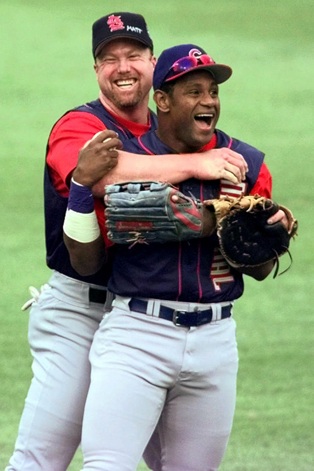 FILE - In this July 12, 1999, file photo, St. Louis Cardinals' Mark McGwire, left, hugs Chicago Cubs' Sammy Sosa in the outfield at Fenway Park during a workout for baseball's All-Star Game in Boston. In a Wednesday, Jan. 23, 2013, interview on the website Ustream.com, Sosa said that he thinks he and fellow steroid-tainted star McGwire belong in the Hall of Fame, that the Cubs should retire his number, and he left open the possibility of running for president of the Dominican Republic. (AP Photo/Stephan Savoia, File)