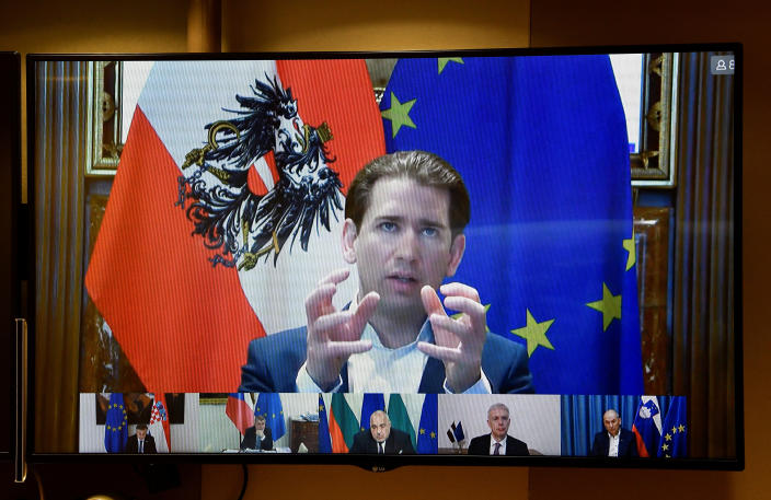 """FILE - In this March 17, 2021, file photo, Austria's Chancellor Sebastian Kurz speaks to European Council President Charles Michel via a video conference meeting at the European Council building in Brussels. Leaders fight over everything from virus passports to push tourism to the conditions for receiving pandemic aid relief. Kurz decried how vaccine-buying in the bloc had become a """"bazaar,"""" alleging poorer countries struck out while the rich thrived. (John Thys, Pool via AP, File)"""