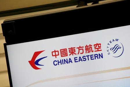 FILE PHOTO: The logo of China Eastern Airlines is shown on a panel at a check-in counter at Hong Kong Airport in Hong Kong