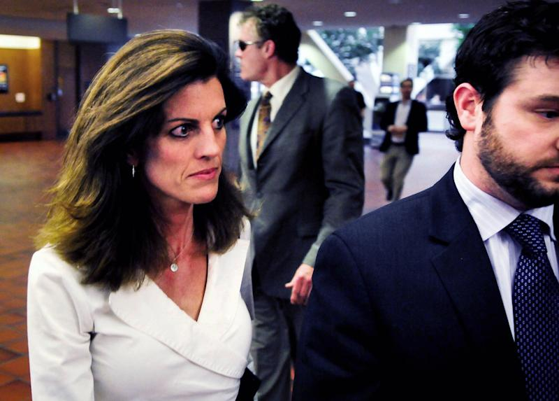 Amy Senser, left, and her attorney, Eric Nelson, right, enter the Hennepin County Government Center before hearing the jury's verdict in her hit-and-run case on Thursday, May 3, 2012, in Minneapolis. Amy Senser was convicted of leaving the scene of an accident and failure to promptly report an accident, both criminal vehicular homicide charges, in the August death of Anousone Phanthavong. She was acquitted of a third felony charge of gross negligence. She was also convicted of misdemeanor careless driving. (AP Photo/Pioneer Press, Jean Pieri)