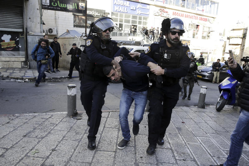 Israel police arrest a Palestinian during a protest against U.S. President Donald Trump's decision to recognize Jerusalem as the capital of Israel in Jerusalem, Saturday, Dec.9, 2017.(AP Photo/Mahmoud Illean)