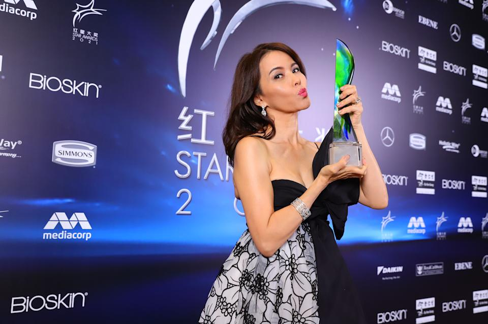 Zoe Tay with her Best Actress Award at Star Awards 2021 held at Changi Airport and the Jewel Changi mall on 18 April 2021. (Photo: Mediacorp)