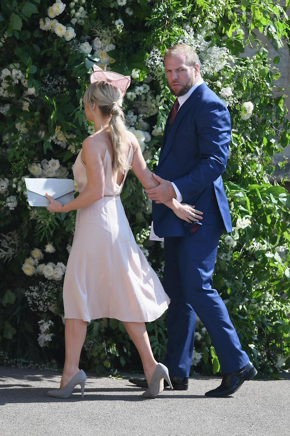 <p>Rugby star James Heskell attends with girlfriend, Chloe Madeley, chosing to attend the royal wedding instead of supporting Wasps in the premiership semi-final. [Photo: Getty] </p>