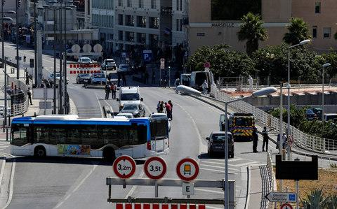 French police secure the area in the French port city of Marseille after one person was killed and another injured after a car crashed into two bus shelters - Credit: PHILIPPE LAURENSON/Reuters