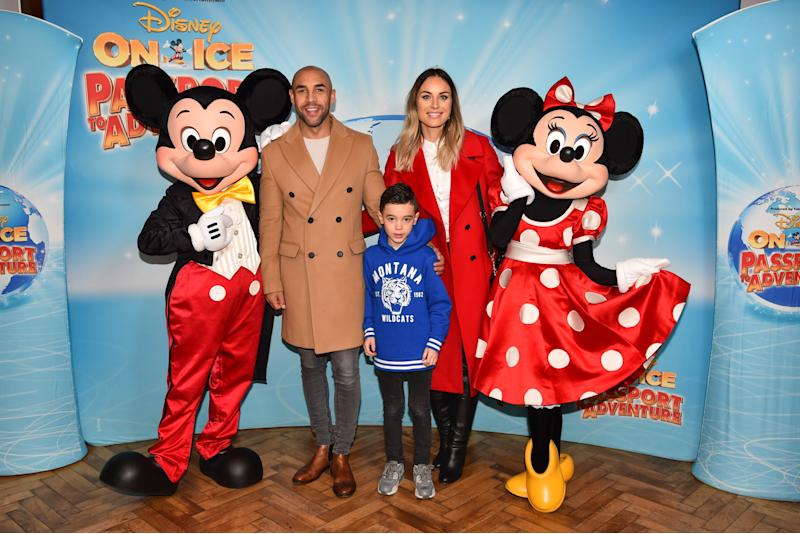 EDITORIAL USE ONLY Alex Beresford, wife Natalie and son Cruz meet Mickey and Minnie Mouse at the opening night of Disney On Ice Passport to Adventure at the O2 Arena from December 20th until December 30th, London.