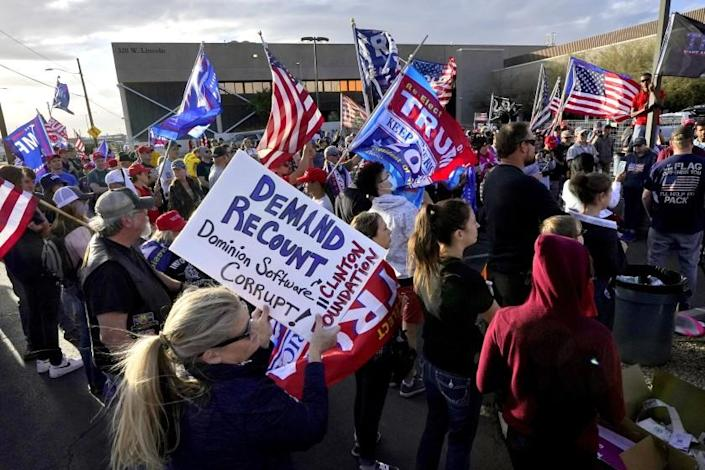 Pro Trump supporters rally outside the Maricopa County Recorder's Office, Saturday, Nov. 7, 2020, in Phoenix. President-elect Joe Biden defeated President Donald Trump on Saturday to become the 46th president of the United States. (AP Photo/Matt York)