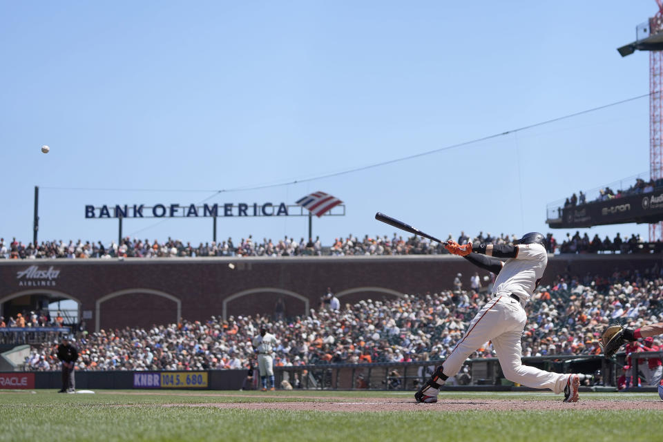 San Francisco Giants' Wilmer Flores hits a solo home run against the Philadelphia Phillies during the fifth inning of a baseball game Sunday, June 20, 2021, in San Francisco. (AP Photo/Tony Avelar)