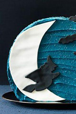 """<p>This deep blue icing hides a pound cake with creamy vanilla frosting inside.</p><p><a href=""""https://www.womansday.com/food-recipes/food-drinks/recipes/a11285/moon-cake-recipe-122731/"""" rel=""""nofollow noopener"""" target=""""_blank"""" data-ylk=""""slk:Get the Moon Cake recipe."""" class=""""link rapid-noclick-resp""""><strong><em>Get the Moon Cake recipe. </em></strong> </a></p>"""