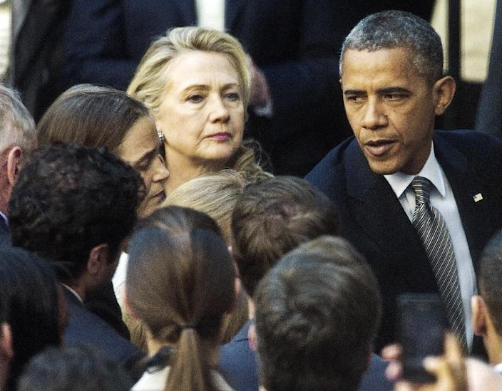 US President Barack Obama and then Secretary of State Hillary Clinton speak to staff members of the US State Department in Washington, DC, on September 12, 2012, regarding the Benghazi attack (AFP Photo/Paul J. Richards)