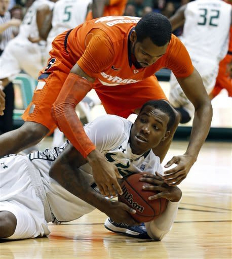 South Florida's Victor Rudd fights to keep the ball from Syracuse's James Southerland during the first half of an NCAA college basketball game Sunday, Jan. 6, 2013, in Tampa, Fla. (AP Photo/Mike Carlson)