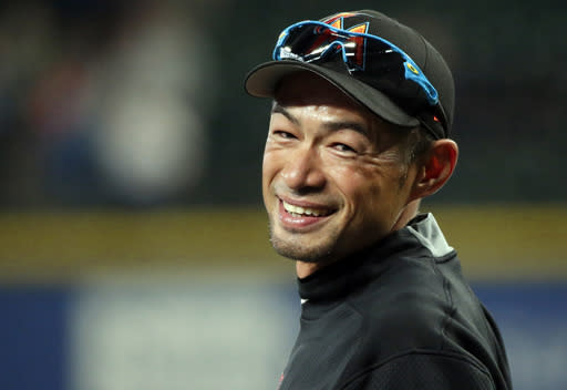 FILE - In this April 17, 2017, file photo, Miami Marlins' Ichiro Suzuki smiles to fans as he takes the field during batting practice before a baseball game against his former team, the Seattle Mariners, in Seattle. The Mariners finalized a one-year deal with 44-year-old Japanese star on Wednesday, March 7, 2018, after several outfielders got hurt. (AP Photo/Ted S. Warren)
