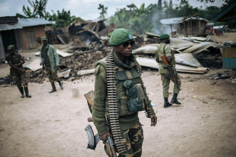 DR Congo troops on patrol in Manzalaho, a village near Beni, after an attack blamed on the ADF