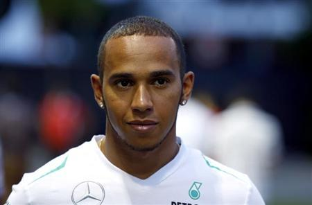 Mercedes Formula One driver Lewis Hamilton of Britain walks in the paddock prior to the Singapore Formula One Grand Prix September 19, 2013. REUTERS/Pablo Sanchez