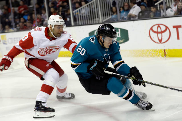 FILE - In this March 12, 2018, file photo, San Jose Sharks' Marcus Sorensen (20) is defended by Detroit Red Wings' Trevor Daley during the second period of an NHL hockey game in San Jose, Calif. Eric Fehr and Sorensen spent most of the season toiling in the AHL, just waiting for their chance. That opportunity has arrived in the playoffs for San Jose and those two fourth-line forwards are a major reason why the Sharks swept Anaheim to advance to a second-round series against Vegas. Fehr scored one goal while anchoring the fourth line and Sorensen had three as San Jose's bottom group of forwards that also includes Melker Karlsson matched the scoring output of the entire Anaheim team in the series. (AP Photo/Marcio Jose Sanchez, File)