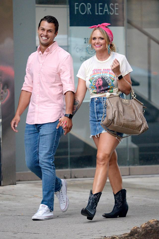 In sync, in pink! Despite his Converse kicks and her cowboy boots, the couple showed they have plenty in common by coordinating their looks on an N.Y.C. stroll.