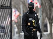 A member of the Secret Service guards a gate near the Eisenhower Executive Office Building