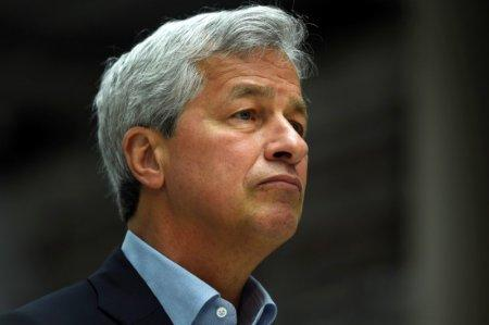 FILE PHOTO: JP Morgan CEO Jamie Dimon speaks at a Remain in the EU campaign event attended by Britain's Chancellor of the Exchequer George Osborne (not shown) at JP Morgan's corporate centre in Bournemouth, southern Britain, June 3, 2016. REUTERS/Dylan Martinez/File Photo