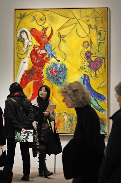 Members of the media stand in front of: La Danse, a 1952 painting by Russian artist Marc Chagall before the opening of the exhibition: Chagall, between War and Peace, at the Luxembourg museum in Paris, Tuesday Feb. 19, 2013. The exhibition starts February 21 and ends July 21, 2013.(AP Photo/Remy de la Mauviniere)