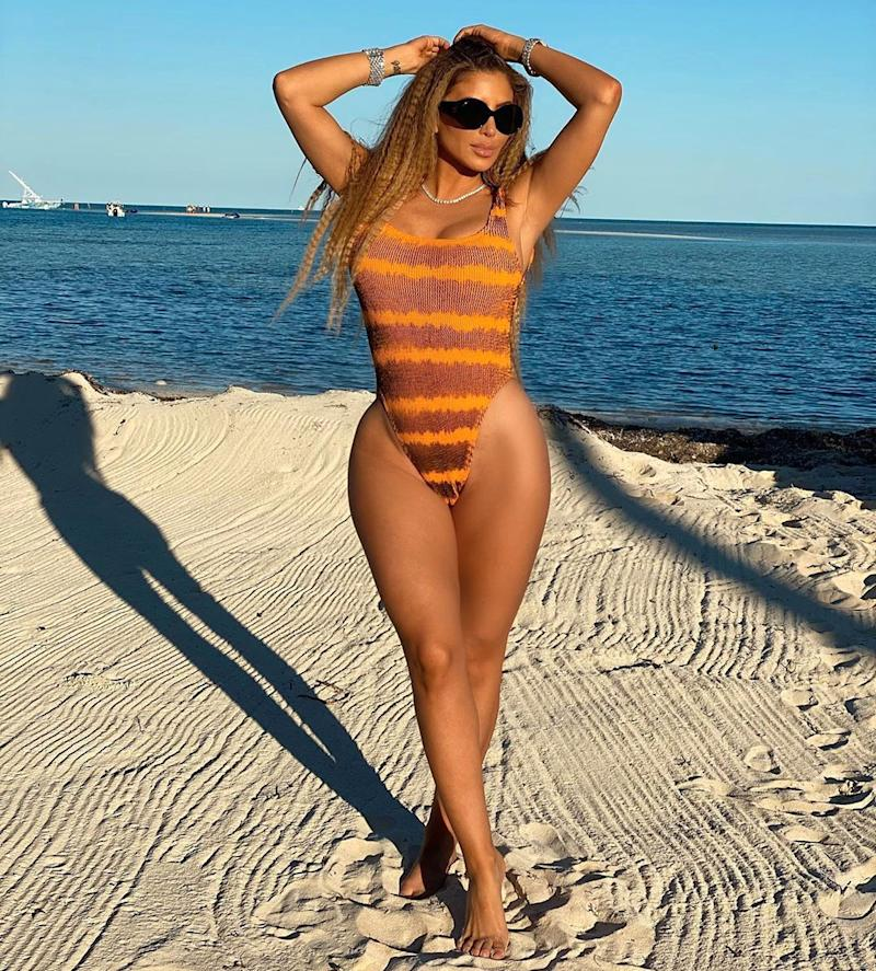 Larsa Pippen poses in a swimsuit