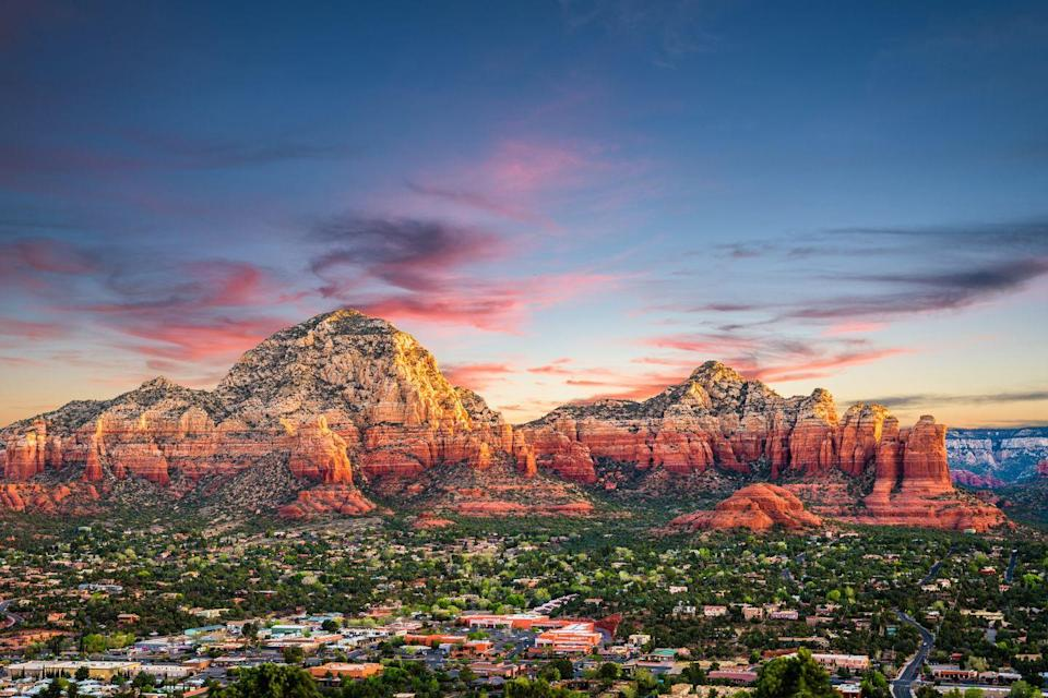 """<p>Wellness enthusiasts and adventure seekers alike have long raved about the beauty and experiences Sedona has to offer. Famous for its vivid crimson skyline, this serene city feels in a world of its own with red-rock canyons and spirit-lifting """"vortexes."""" <a href=""""https://www.lauberge.com/"""" rel=""""nofollow noopener"""" target=""""_blank"""" data-ylk=""""slk:L'Auberge de Sedona"""" class=""""link rapid-noclick-resp"""">L'Auberge de Sedona</a> allows guests to enjoy all the wonders of alfresco living with its luxe creekside lodges, impressive outdoor showers, and fine-dining options.</p><p>Can't miss beautiful places: <a href=""""https://www.miiamo.com/"""" rel=""""nofollow noopener"""" target=""""_blank"""" data-ylk=""""slk:Mii Amo"""" class=""""link rapid-noclick-resp"""">Mii Amo</a>, <a href=""""https://www.tlaq.com/"""" rel=""""nofollow noopener"""" target=""""_blank"""" data-ylk=""""slk:Tlaquepaque Arts & Crafts Village"""" class=""""link rapid-noclick-resp"""">Tlaquepaque Arts & Crafts Village</a>, and Cathedral Rock Trail</p>"""