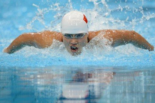 China's Lu Ying competes in the women's 100m butterfly semi-final at the London 2012 Olympic Games. Lu, who went on to win silver in the final of the event, has criticised China's restrictive training methods compared to the freedom of working out in Australia, giving a rare insight into the closed world of Chinese swimming