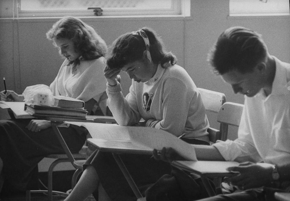 <p>Taking an exam in an actual classroom, not turning it in digitally on your own schedule. </p>