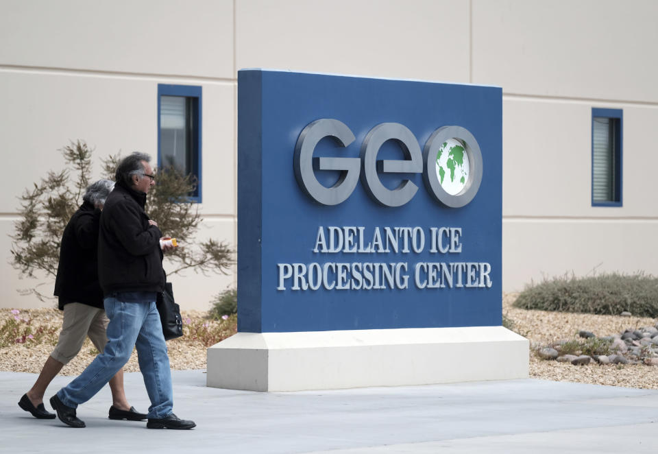 FILE - This April 20, 2019, file photo shows the U.S. Immigration and Enforcement Processing Center operated by GEO Group, Inc. (GEO) a Florida-based company specializing in privatized corrections in Adelanto, Calif. A federal appeals court has tossed out California's ban on privately owned immigration detention facilities, keeping intact a key piece of the world's largest detention system for immigrants. A divided three-judge panel of the 9th Circuit Court of Appeals said Tuesday, Oct. 5, 2021, that it found the ban interferes with the federal government's authority to enforce the law. (AP Photo/Richard Vogel, File)