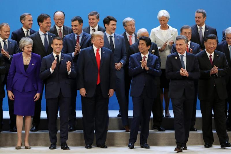 Donald Trump poses in the G20 photo with other world leaders (AP)