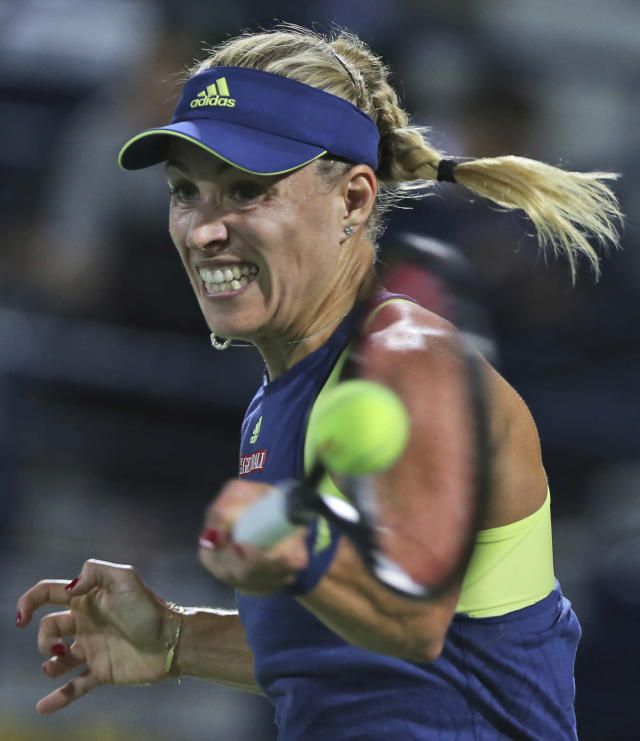 Angelique Kerber of Germany returns the ball to Elina Svitolina of Ukraine during a semi final match of the Dubai Duty Free Tennis Championship in Dubai, United Arab Emirates, Friday, Feb. 23, 2018. (AP Photo/Kamran Jebreili)
