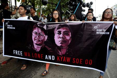 People march to show solidarity for jailed Reuters journalists Wa Lone and Kyaw Soe Oo in Yangon, Myanmar, September 1, 2018. REUTERS/Ann Wang/File Photo