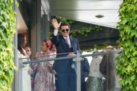Actor Tom Cruise waves at the end of the women's singles final match between Australia's Ashleigh Barty and Czech Republic's Karolina Pliskova on day twelve of the Wimbledon Tennis Championships in London, Saturday, July 10, 2021. (AP Photo/Alberto Pezzali)