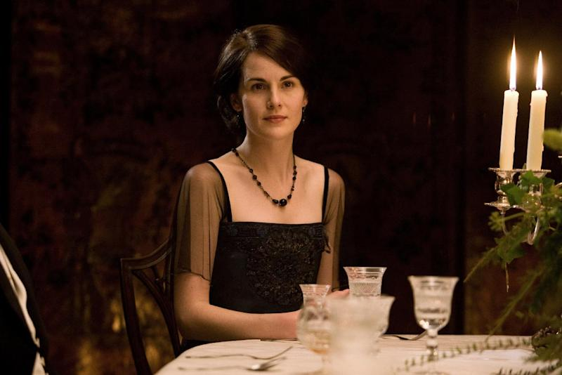 "In this image released by PBS, Michelle Dockery portrays Lady Mary in a scene from ""Downton Abbey."" Dockery was nominated for an Emmy Award for best actress in a drama series on Thursday July 10, 2014. The 66th Primetime Emmy Awards will be presented Aug. 25 at the Nokia Theatre in Los Angeles. (AP Photo/PBS, Carnival Film & Television Limited 2011 for MASTERPIECE)"