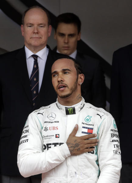 Mercedes driver Lewis Hamilton of Britain sings the anthem in front of Prince Albert II of Monaco after winning the Monaco Formula One Grand Prix race, at the Monaco racetrack, in Monaco, Sunday, May 26, 2019. (AP Photo/Luca Bruno)