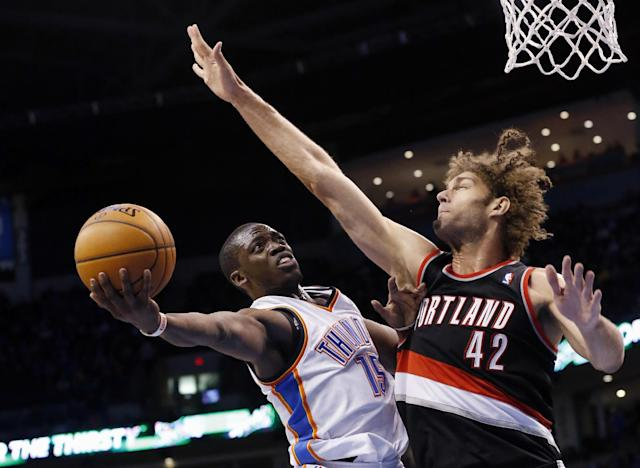 Oklahoma City Thunder guard Reggie Jackson (15) shoots as Portland Trail Blazers center Robin Lopez (42) defends in the third quarter of an NBA basketball game in Oklahoma City, Tuesday, Jan. 21, 2014. Oklahoma City won 105-97. (AP Photo/Sue Ogrocki)