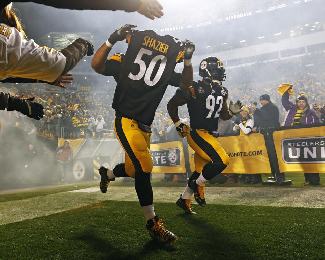 <p>Pittsburgh Steelers defensive end Cameron Heyward (97) takes the field holding the jersey of teammate Ryan Shazier (50) during introductions before an NFL football game against the Baltimore Ravens in Pittsburgh, Sunday, Dec. 10, 2017. (AP Photo/Keith Srakocic) </p>