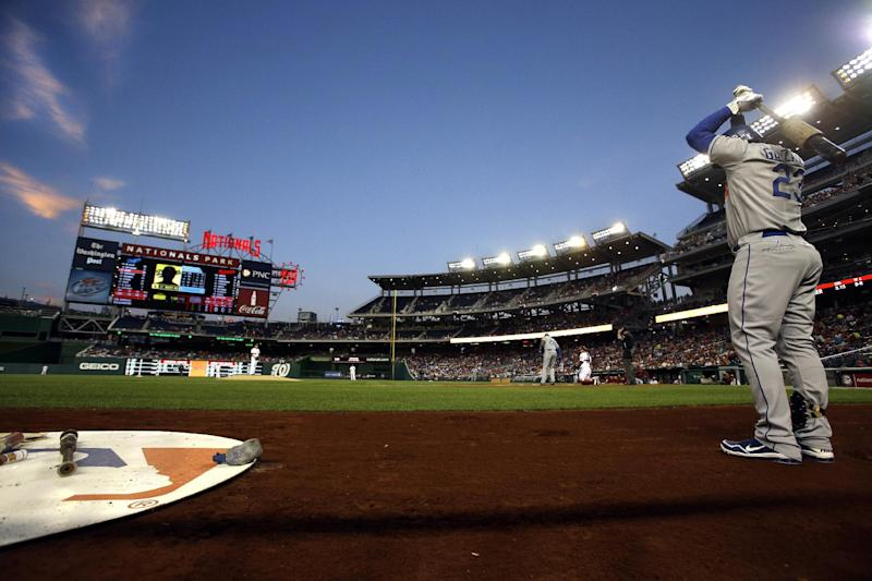 Los Angeles Dodgers' Adrian Gonzalez (23) warms up before batting against the Washington Nationals during the first inning of a baseball game at Nationals Park in Washington, Thursday, Sept. 20, 2012. The Nationals won 4-1. (AP Photo/Jacquelyn Martin)
