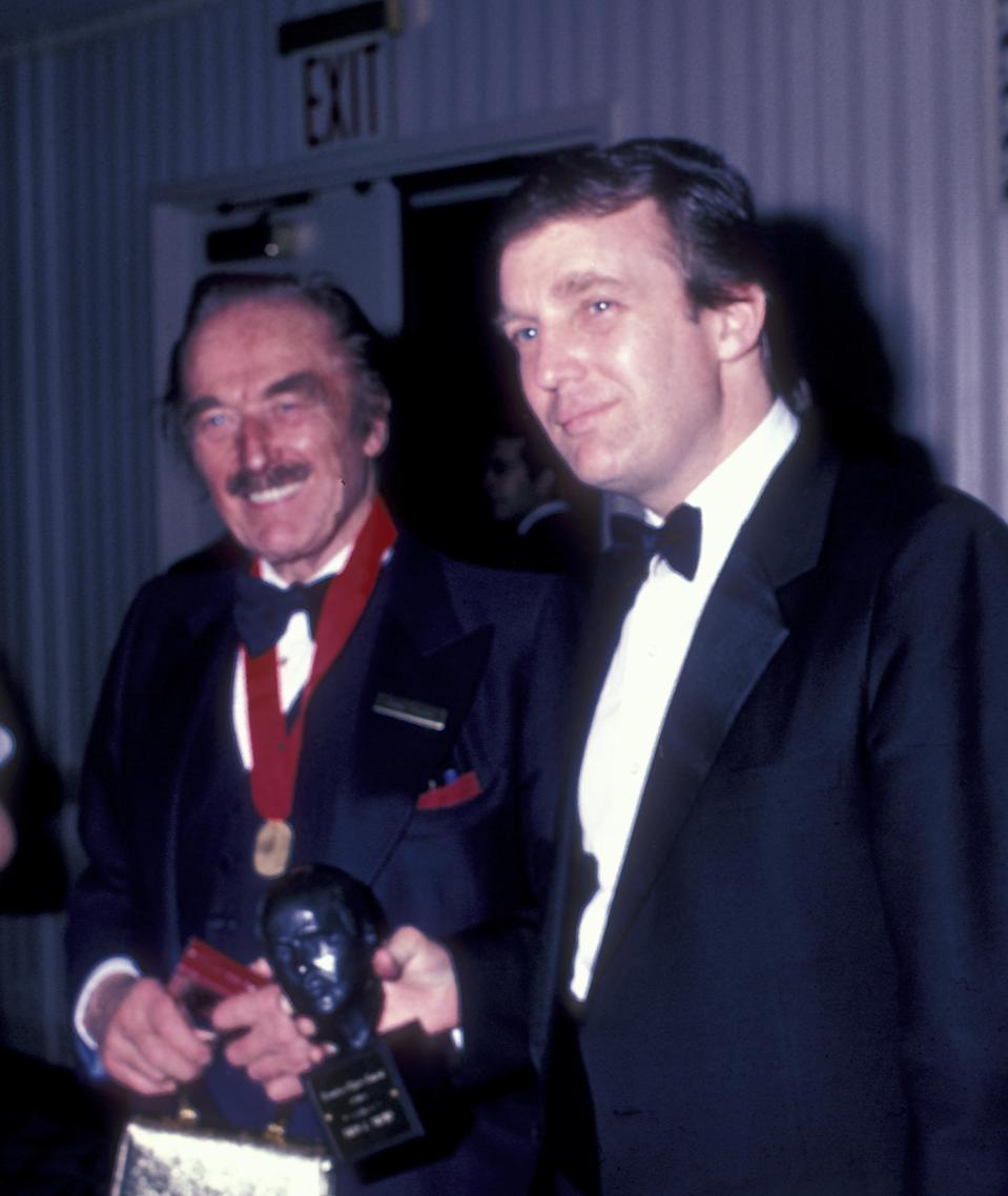 A new report suggests that Donald Trump's diagnosis of bone spurs may have been made at the request of his father, Fred Trump (pictured with his son in 1985). (Photo: Ron Galella/WireImage)