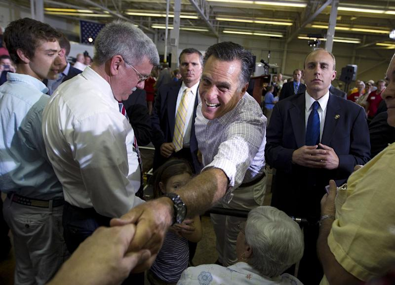 Republican presidential candidate, former Massachusetts Gov. Mitt Romney shakes hands during a campaign event at Horizontal Wireline Services on Tuesday, July 17, 2012 in Irwin, Pa. (AP Photo/Evan Vucci)
