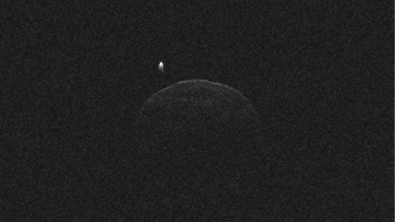 This image of asteroid 1998 QE2 was obtained on June 1, 2013, when the asteroid was about 3.75 million miles (6 million kilometers) from Earth. The small white dot at upper left is the moon, or satellite, orbiting asteroid 1998 QE2.