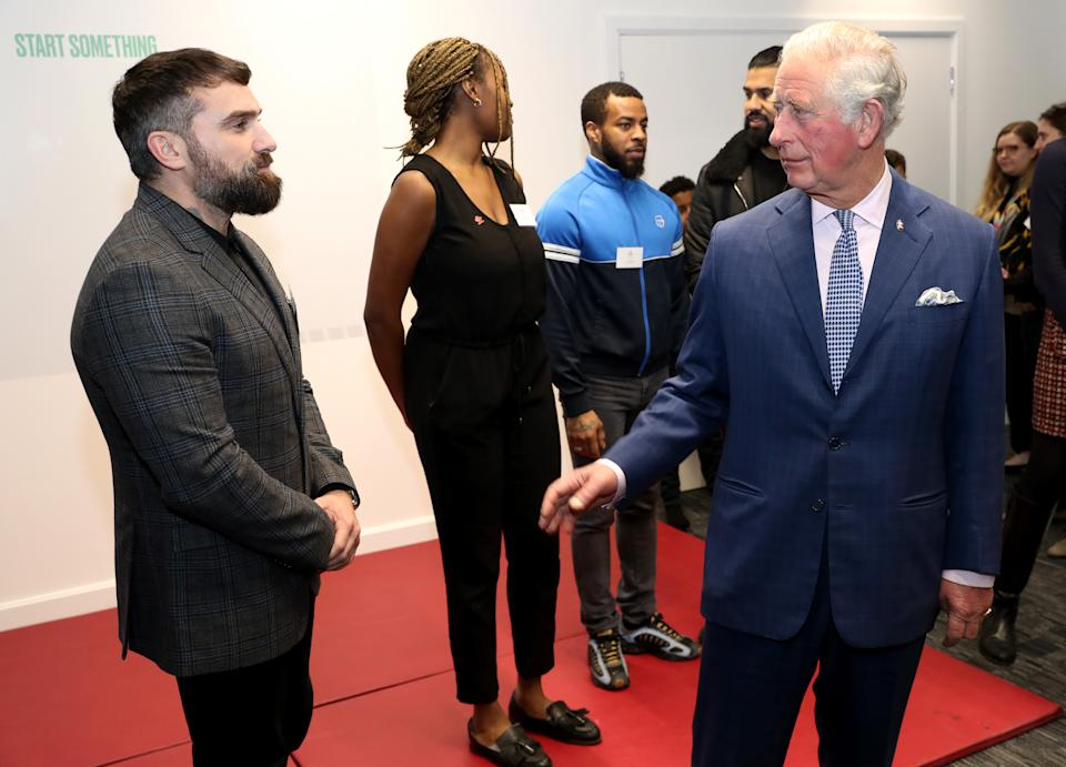 The Prince of Wales speaks with Ant Middleton (left) during the opening of the Prince's Trust charity's new south London centre in Southwark.