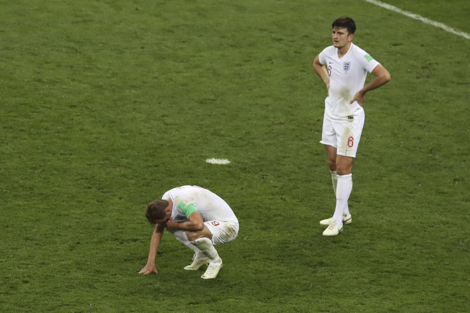 <p>Harry Kane and Harry Maguire are dejected at the final whistle </p>