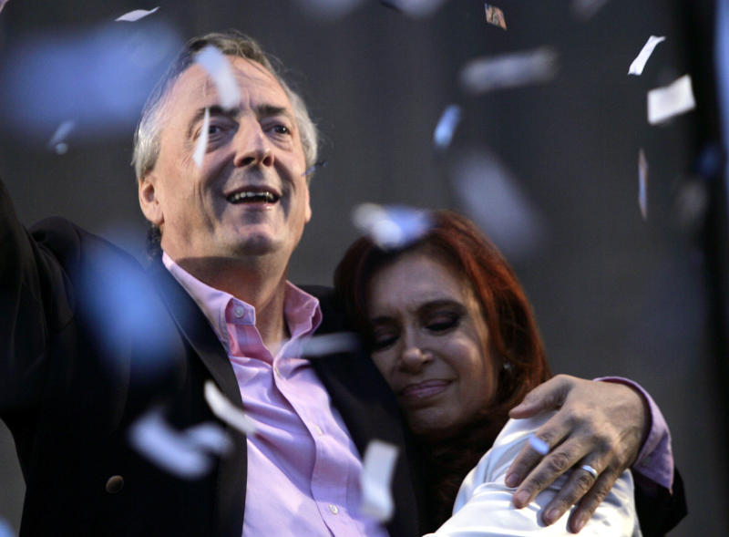 "FILE - In this Oct. 25, 2007 file photo, Argentina's President Nestor Kirchner embraces his wife presidential candidate Cristina Fernandez at the end of the closing campaign rally in Buenos Aires, Argentina. A documentary film titled ""Nestor Kirchner"" hits the theaters on Thursday, Nov. 22, 2012, the latest example of an ongoing effort to exalt the late president's memory, seeking to match the level of Juan Domingo Peron.  Streets, hospitals, tunnels and even a soccer tournament is named after Nestor Kirchner, who served as president from 2003 to 2007 and died at the age of 60 on Oct. 27, 2010.  (AP Photo/Jorge Saenz, File)"