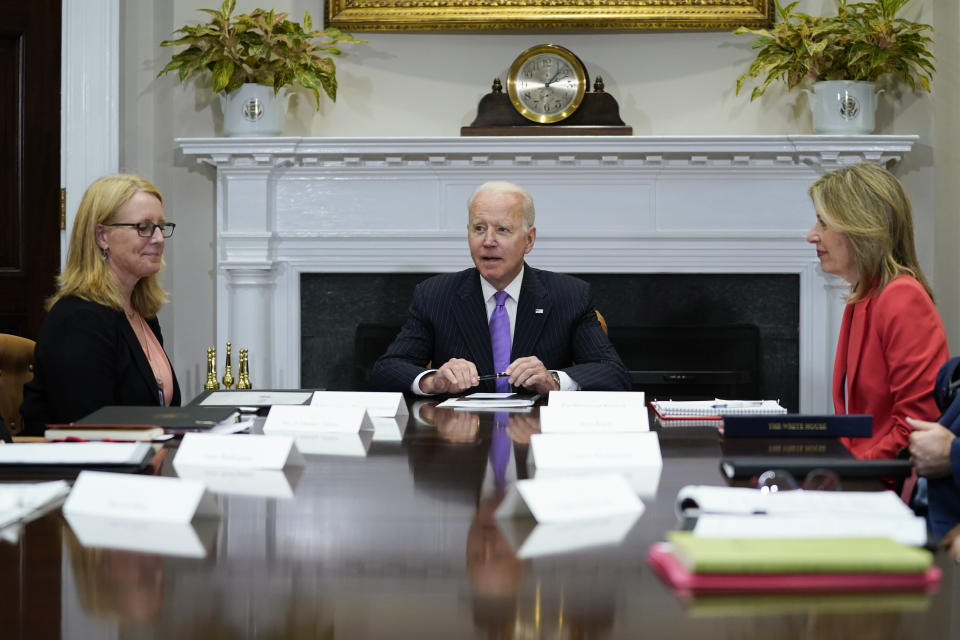 President Joe Biden speaks during a meeting with FEMA Administrator Deanne Criswell, left, and Homeland Security Adviser and Deputy National Security Adviser Elizabeth Sherwood-Randall, right, in the Roosevelt Room of the White House, Tuesday, June 22, 2021, in Washington. (AP Photo/Evan Vucci)